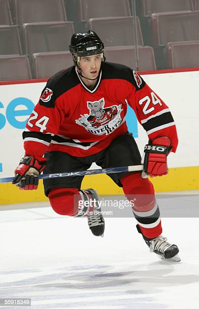 Right wing Barry Tallackson of the Albany River Rats skates on the ice during the game against the Philadelphia Phantoms on October 9 2005 at the...