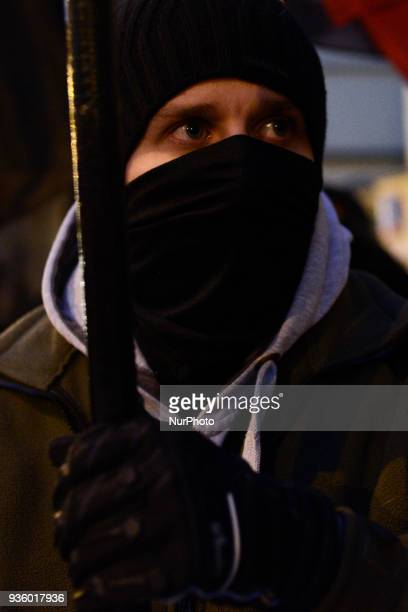 Right wing demonstrators are seen gathered in front of the Ukrainian embassy in Warsaw Poland on March 19 2018 in protest of Ukraines refusal to...