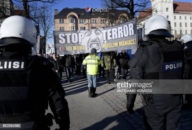 Right wing demonstrators protest at the Helsinki Railway Square Finland on March 11 2017 Some right wing protesters called for the dismantling of the...