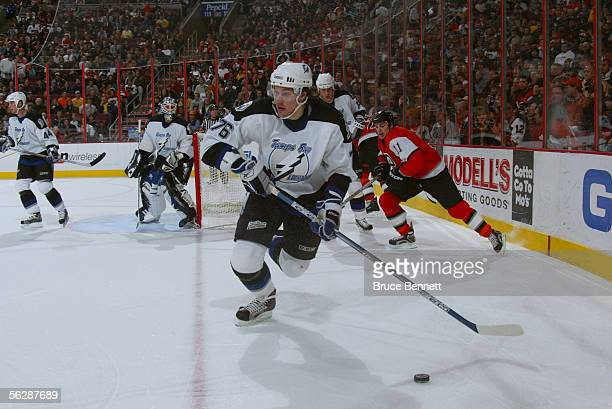 Right wing Evgeny Artyukhin of the Tampa Bay Lightning controls the puck during the game against the Philadelphia Flyers at the Wachovia Center on...