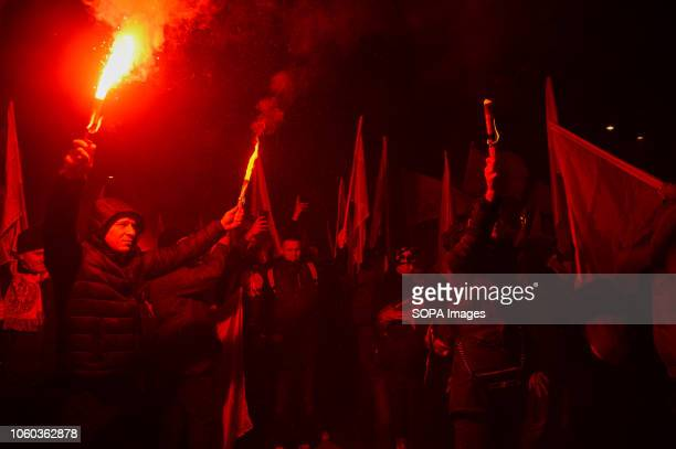 Right wing extremist seen holding flares during the official march organized by the Polish government at Rondo Dmowskiego Days before the...
