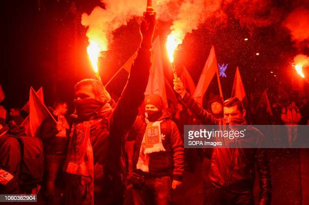 Right wing extremists are seen holding flares during the official march organized by the Polish government at Rondo Dmowskiego Days before the...