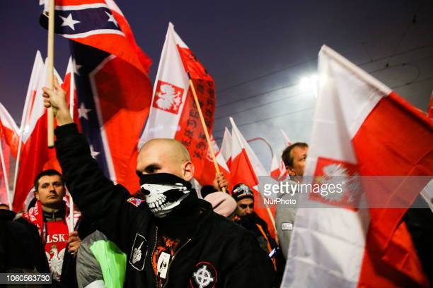 Right wing extremists attend 'White-and-red independence march' to celebrate the 100th anniversary of Poland regaining independence. Warsaw, Poland...