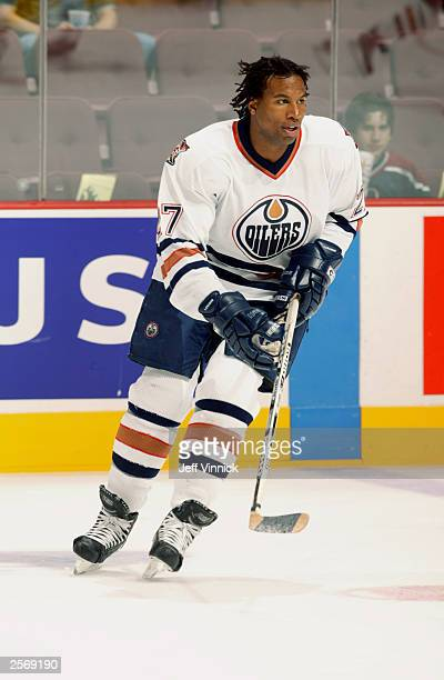 Right wing Georges Laraque of the Edmonton Oilers skates against the Vancouver Canucks during the preseason NHL game on September 30, 2003 at General...
