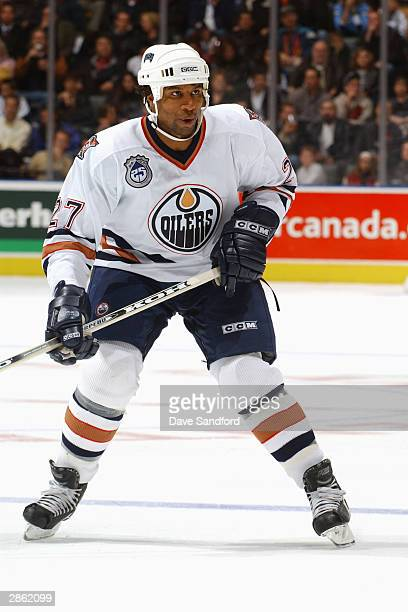 Right wing Georges Laraque of the Edmonton Oilers skates on the ice during the game against the Toronto Maple Leafs at Air Canada Centre on November...