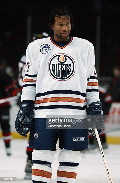 Right wing Georges Laraque of the Edmonton Oilers stands on the ice before the game against the Chicago Blackhawks at the United Center on March 7...