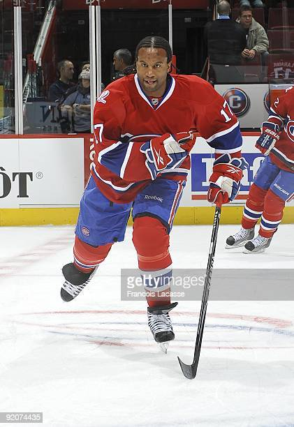 Right Wing Georges Laraque of the Montreal Canadiens warms up with Left Wing Travis Moen of the Montreal Canadiens before the NHL game against the...