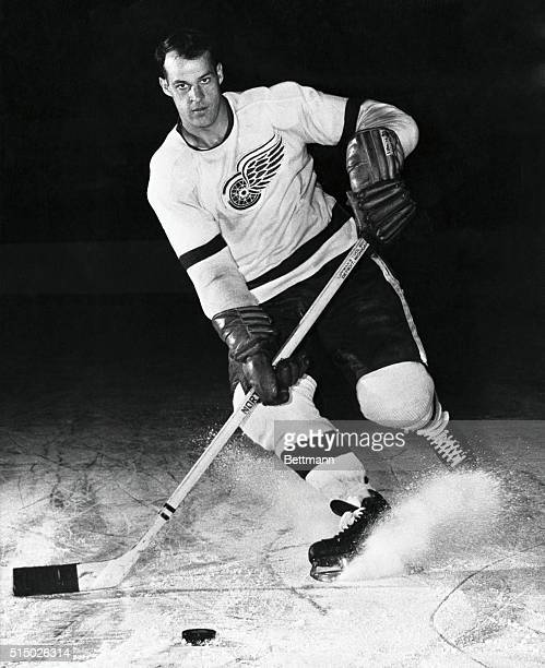 Right wing Gordie Howe of the Detroit Red Wings controls the puck.