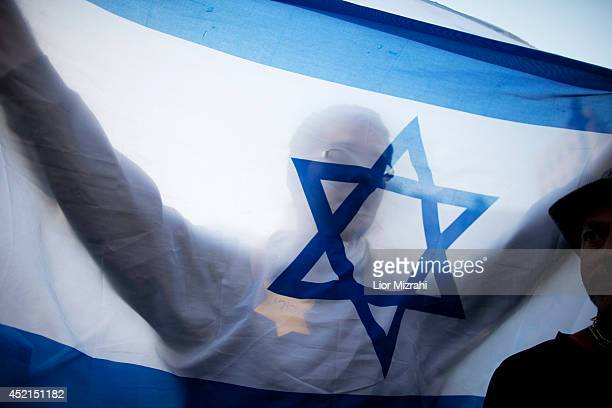 A right wing Israeli holds an Israeli flag during a demostration in support of Israel's operration in the Gaza Strip on July 14 2014 in Jerusalem...