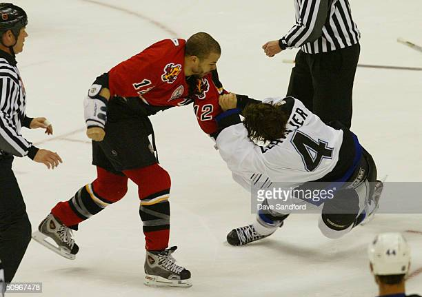 Right wing Jarome Iginla of the Calgary Flames fights with center Vincent Lecavalier of the Tampa Bay Lightning in Game three of the NHL Stanley Cup...