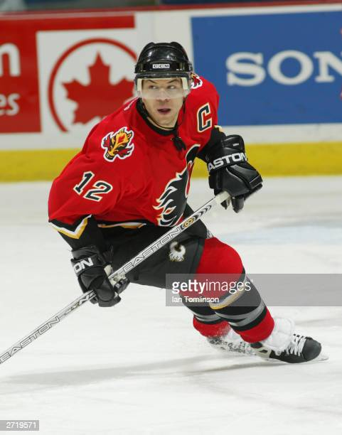 Right wing Jarome Iginla of the Calgary Flames skates up the ice during the game against the Detroit Red Wings on November 4 2003 at The Pengrowth...