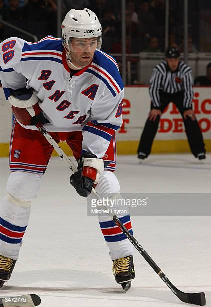 Right wing Jaromir Jagr of the New York Rangers controls the puck during the game against the Washington Capitals at the MCI Center on March 18, 2004...