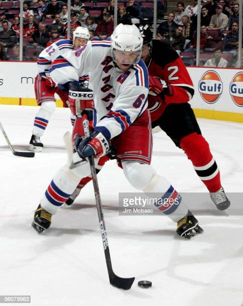 Right wing Jaromir Jagr of the New York Rangers controls the puck against defenseman Vladimir Malakhov of the New Jersey Devils during their game on...