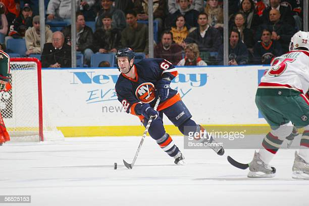 Right wing Kevin Colley of the New York Islanders handles the puck against the Minnesota Wild at the Nassau Coliseum on December 13 2005 in Uniondale...