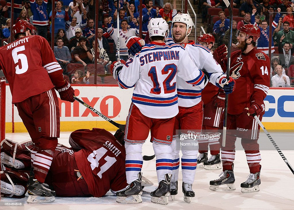 Right wing Lee Stempniak #12 of the New York Rangers (left) celebrates his third period goal with left wing Tanner Glass #15 (right) during the third period of the NHL game against the Arizona Coyotes at Gila River Arena on February 14, 2015 in Glendale, Arizona.