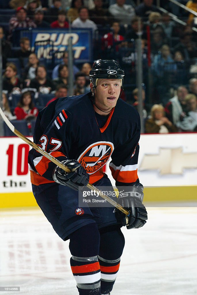 Right wing Mark Parrish #37 of the New York Islanders skates against the Buffalo Sabres during the NHL game on October 10, 2002 at HSBC Arena in Buffalo, New York. The Sabres defeated the Islanders 5-1.
