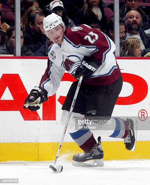 Right wing Milan Hejduk of the Colorado Avalanche skates with the puck against the New Jersey Devils during their game on December 9, 2005 at...