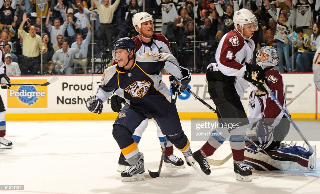 Right wing Patric Hornqvist #27 of the Nashville Predators celebrates after scoring a game tying goal against defensemen Adam Foote #52 and John-Michael Liles and goalie Craig Anderson #41 of the Colorado Avalanche on October 8, 2009 at the Sommet Center in Nashville, Tennessee.