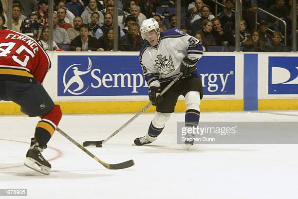 Right wing Pavel Rosa of the Los Angeles Kings shoots the puck while being defended by Brad Ference of the Florida Panthers during the NHL game on...