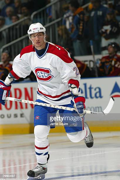 Right wing Pierre Dagenais of the Montreal Canadiens skates on the ice against the Atlanta Thrashers at Philips Arena on January 14, 2004 in Atlanta,...