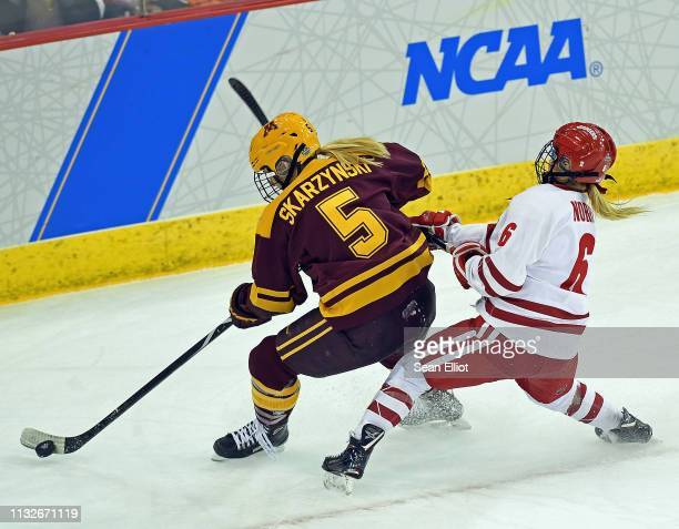 Right wing Presley Norby of the Wisconsin Badgers pursues defender SopheieSkarzysnki of the Minnesota Golden Gophers during the second period of the...