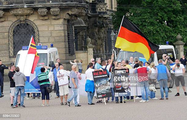 Right wing protesters rally against the presence of the Bilderberg meeting while many of the Bilderberg conference participants take a tour of the...