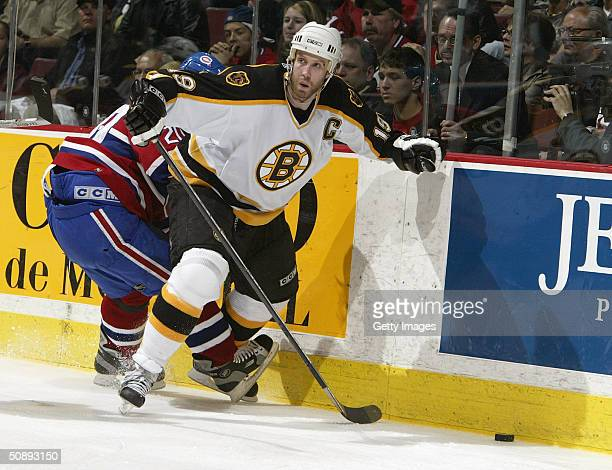 Right wing Richard Zednick of the Montreal Canadiens battles for the puck with center Joe Thornton of the Boston Bruins during game six of the...