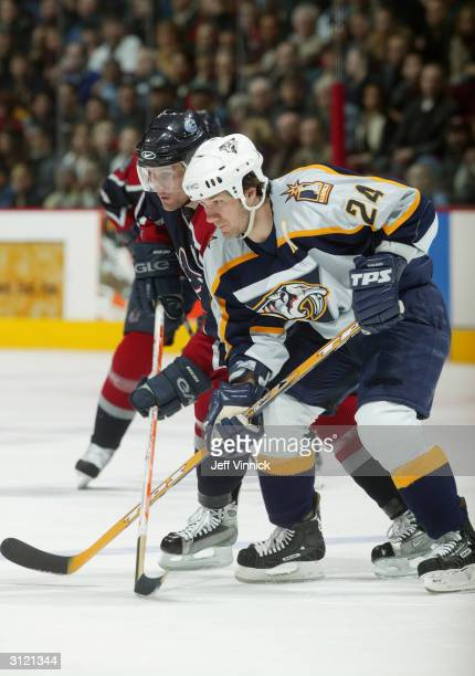 Right wing Scott Walker of the Nashville Predators waits for the face off with left wing Markus Naslund of the Vancouver Canucks during the game at...