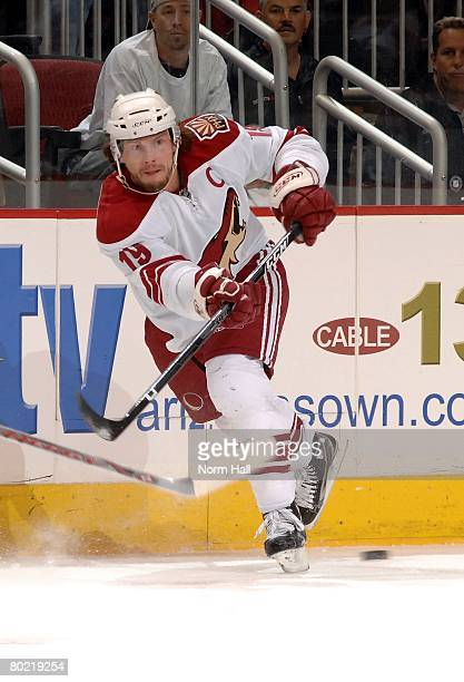 Right Wing Shane Doan of the Phoenix Coyotes passes the puck against the Ottawa Senators on March 8 2008 at Jobingcom Arena in Glendale Arizona