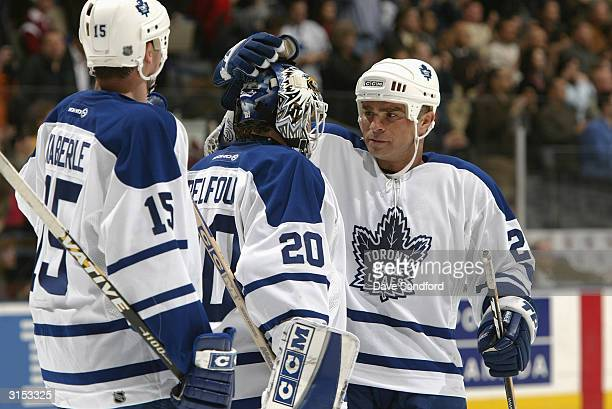 0ef634016a7 Right wing Tie Domi of the Toronto Maple Leafs celebrates with goalie Ed  Belfour and defender