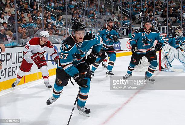Right wing Tommy Wingels defenseman Colin White and defenseman Jason Demers of the San Jose Sharks skate up the ice against Right wingMikkei Boedker...