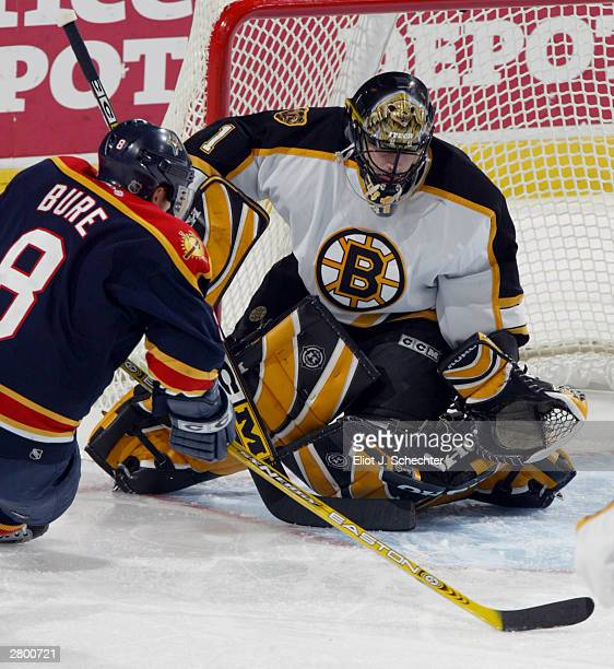 Right wing Valeri Bure of the Florida Panthers scores a goal against Goalie Andrew Raycroft of the Boston Bruins in NHL action on December 10, 2003...