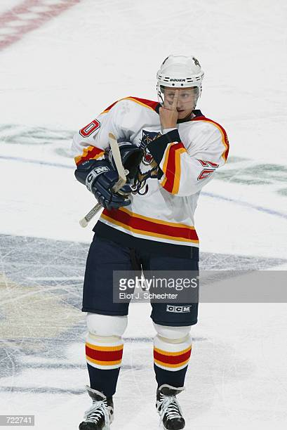 Right wing Valeri Bure of the Florida Panthers wipes his face during a break in action against the Washington Capitals during the game on January 12...