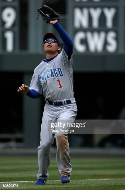 Rightfielder Kosuke Fukudome of the Chicago Cubs catches a pop fly by Chris Iannetta of the Colorado Rockies in foul territory in the second inning...