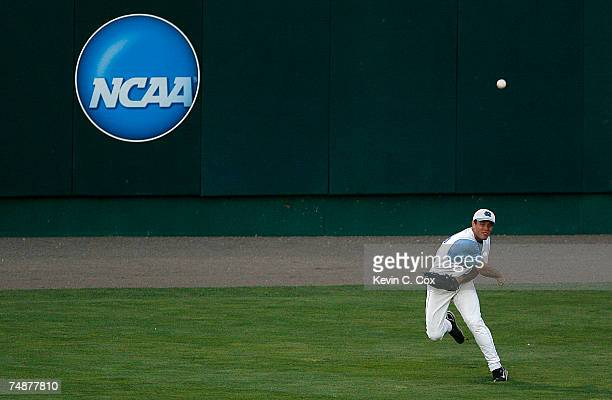 Rightfielder Tim Fedroff of the North Carolina Tar Heels tosses a ball in from the outfield during their 9-3 loss to the Oregon State Beavers in Game...
