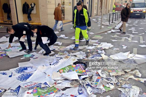 Rightist UMP party members pick up leaflets and posters of the party after protestors antiCPE occupied the UMP offices 13 March 2006 in Lyon French...