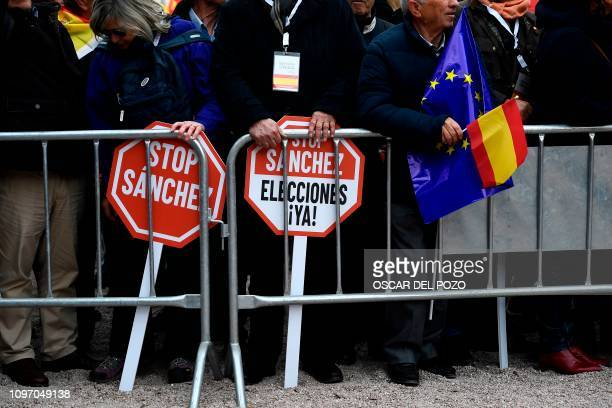 Rightprotesters hold signs calling for elections and reading Stop Sanchez during a demonstration in Madrid against Spanish Prime Minister Pedro...