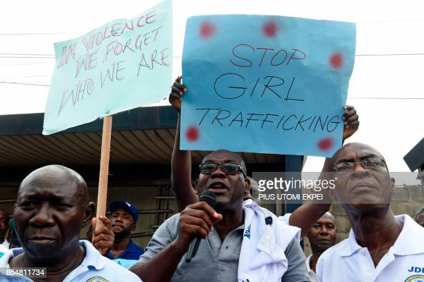 Rights activist Achike Chude speaks against violence trafficking and child abuse as rights activists under the umbrella of the Justice Development...