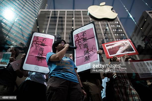Rights campaigners stage a protest coinciding with the launch of the new iPhone 6s outside an Apple store in Hong Kong on September 25 2015 Apple was...