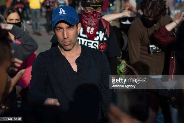 Right-wing activist Ami Horowitz speaks with protesters inside the âCapitol Hill Organized Protestâ formerly known as the âCapitol Hill Autonomous...