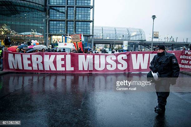 Rightwing activists gather in front of Hauptbahnhof main railway station before marching through the city center on November 5 2016 in Berlin Germany...