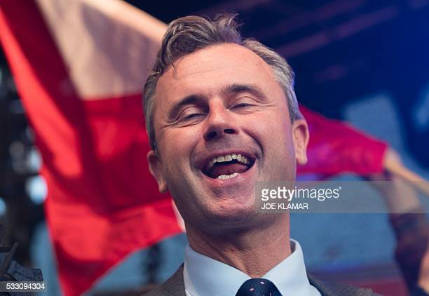 Rightwing Austrian Freedom Party presidential candidate Norbert Hofer sings on stage during his final election campaign rally at the Viktor Adler...