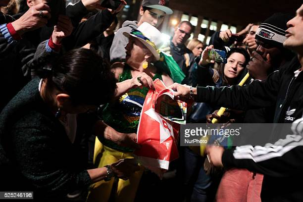 Rightwing Brazilian nationalists burn flags and pamphlets of the Workers Party in the Paulista Avenue during a rightwing nationalist protest against...
