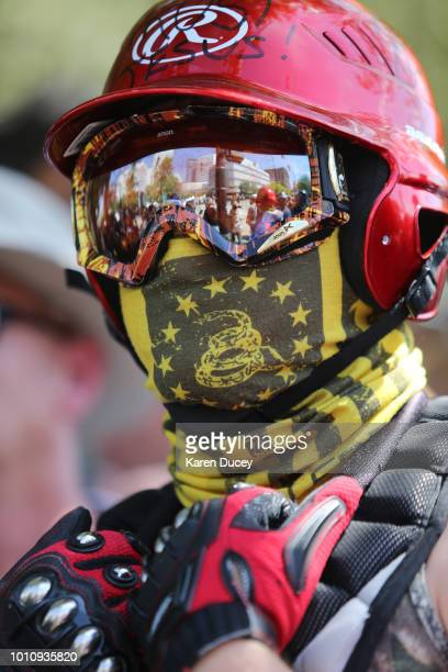 A rightwing demonstrator looks on during a rally supporting gun rights and free speech on August 4 2018 in Portland Oregon The rally was organized by...