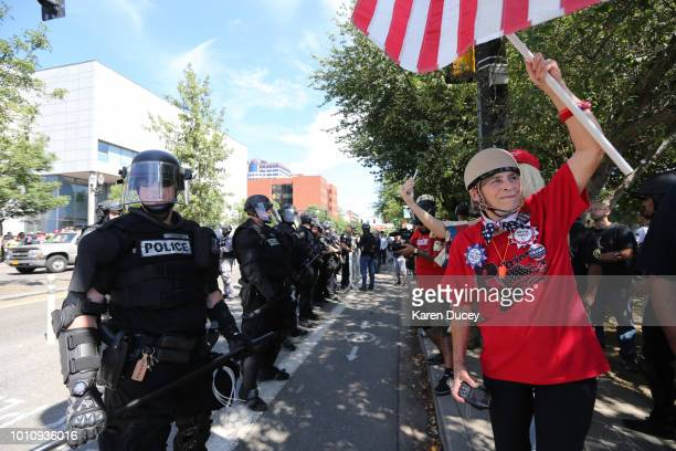 Rightwing demonstrators hold a rally supporting gun rights and free speech as riot police stand guard on August 4 2018 in Portland Oregon The rally...