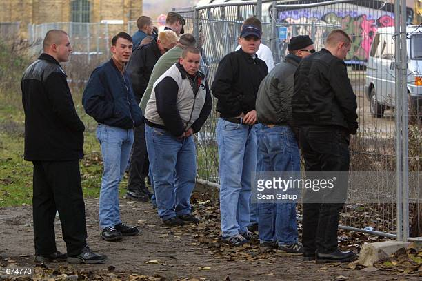 Rightwing demonstrators urinate on the sidelines of a march in central Berlin December 1 2001 to protest a current exhibition that details atrocities...