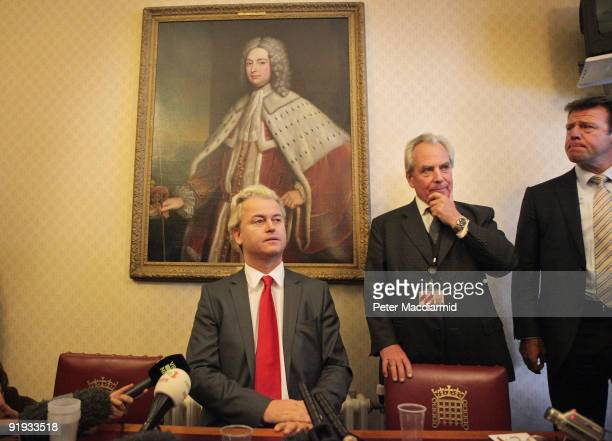 Rightwing Dutch MP Geert Wilders is watched by Lord Pearson and a security official as he speaks to reporters near Parliament on October 16 2009 in...