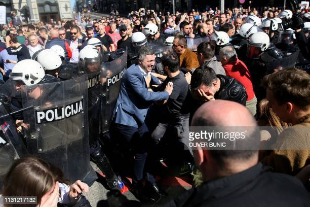 TOPSHOT Rightwing Dveri party leader Bosko Obradovic scuffles with police forces during a demonstration against Serbian President Aleksandar Vucic...