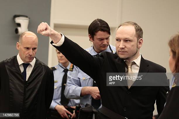 Rightwing extremist Anders Behring Breivik who killed 77 people in twin attacks in Norway last year makes a farright salute as he enters court on...