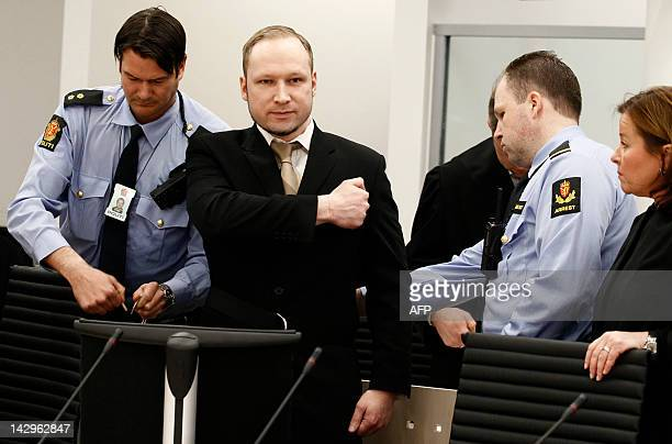 Rightwing extremist Anders Behring Breivik who killed 77 people in twin attacks in Norway last year makes a farright salute as he enters court in...